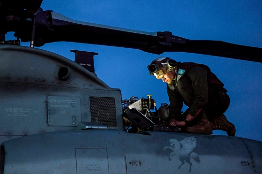 150317-N-BD107-043 PACIFIC OCEAN (March 16, 2015) A Marine from the Greyhawks of Marine Medium Tilitorotor Squadron (VMM) 161 (Reinforced) performs maintenance on an AH-1 Cobra helicopter on the flight deck of the San Antonio-class amphibious transport dock ship USS Anchorage (LPD 23). Anchorage is underway participating in a composite training unit exercise. (U.S. Navy photo by Mass Communication Specialist 3rd Class Liam Kennedy/Released)