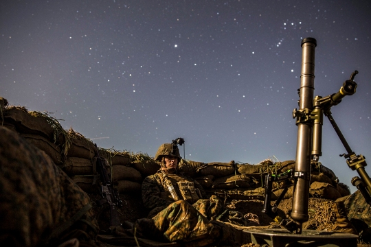 U.S. Marine Lance Cpl. Griffin Forrester stands his post in his fighting hole during a beach raid aboard Camp Pendleton, Calif., March 6, 2015. After securing the beach, Marines tactically moved to Camp Horno, where the Marines dug fighting holes and trained in defensive tactics during Amphibious Squadron/Marine Expeditionary Unit Integration Training (PMINT). (U.S. Marine Corps photo by Sgt. Emmanuel Ramos/Released)