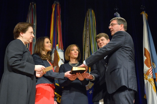 Associate Justice of the Supreme Court Elena Kagan administers the oath of office to Secretary of Defense Ash Carter during a ceremonial swearing in held in the Pentagon Auditorium, March 6, 2015.  DoD photo by Glenn Fawcett (Released)