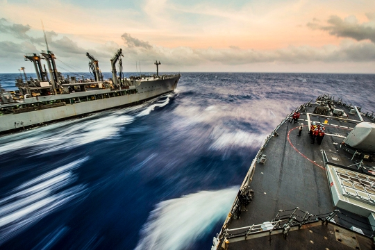 150326-N-XM324-055 WATERS NEAR GUAM (March 26, 2015) Arleigh Burke-class guided-missile destroyer USS Fitzgerald (DDG 62) (right) comes alongside the Military Sealift Command fleet replenishment oiler USNS Pecos (T-AO 197) for a replenishment-at-sea during Multi-Sail 2015. Multi-Sail in an annual Destroyer Squadron 15 exercise designed to assess combat systems, improve teamwork and increase warfighting capabilities in the Seventh Fleet area of responsibility. Japan Maritime Self-Defense Force (JMSDF) is participating in Multi-Sail for the first time to improve interoperability and strengthen U.S.-Japan alliance.  (U.S. Navy photo by Mass Communication Specialist Seaman Patrick Dionne/Released)