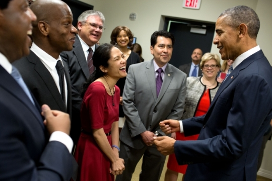 President Barack Obama jokes with Anne Ha of Philadelphia, Pa., and other guests backstage prior to an event marking the fifth anniversary of the Affordable Care Act (ACA) and kick-off of the Health Care Payment Learning and Action Network, in the Eisenhower Executive Office Building South Court Auditorium, March 25, 2015. Ha, who signed up for health insurance though the Affordable Care Act and was later diagnosed with cancer, attributes the insurance with saving her life. (Official White House Photo by Pete Souza)