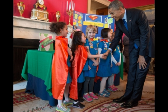 President Barack Obama greets Emily Bergenroth, Alicia Cutter, Karissa Cheng, Addy O'Neal, and Emery Dodson, all six-year-old Girl Scouts, from Tulsa, Oklahoma as he viewed their science exhibit during the 2015 White House Science Fair celebrating student winners of a broad range of science, technology, engineering, and math (STEM) competitions, in the Red Room, March 23, 2015. The girls used Lego pieces and designed a battery-powered page turner to help people who are paralyzed or have arthritis. (Official White House Photo by Pete Souza)