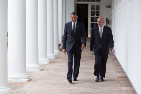 President Barack Obama and President Ashraf Ghani of Afghanistan walk on the Colonnade en route to a working lunch in the Old Family Dining Room of the White House, March 24, 2015. (Official White House Photo by Pete Souza)