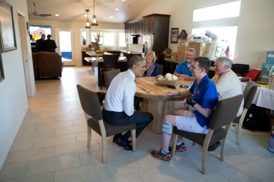 President Barack Obama visits with Sgt. 1st Class Cory Remsburg and family members at his newly finished home in Gilbert, Arizona, March 13, 2015. Remsburg suffered a severe brain injury in Afghanistan several years ago and has made remarkable progress. (Official White House Photo by Pete Souza)