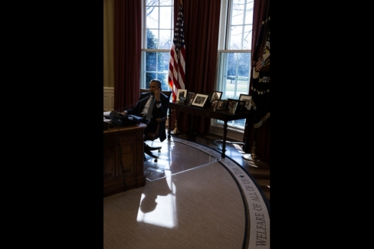 President Barack Obama talks on the phone with Chancellor Angela Merkel of Germany in the Oval Office, March 18, 2015. (Official White House Photo by Pete Souza)