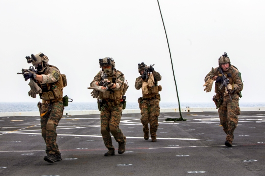 U.S. Marines with Maritime Raid Force, 31st Marine Expeditionary Unit conduct a fast rope exercise as part of amphibious intergration training aboard the USS Green Bay (LPD 20), at sea, March 10, 2015. The Marines and Sailors are currently conducting their Spring Patrol of the Asia-Pacific region.  (U.S. Marine Corps photo by GySgt Ismael Pena/Released)