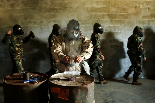 Sgt. Carlos Iruegas, U.S. Marine Corps Forces, Pacific chemical, biological, radiological and nuclear defense chief, prepares the CS gas (tear gas) at the gas chamber aboard Marine Corps Base Hawaii March 19, 2015. Gas chamber training is part of an annual training requirement for Marines. (U.S. Marine Corps photo by Sgt. Sarah Dietz)