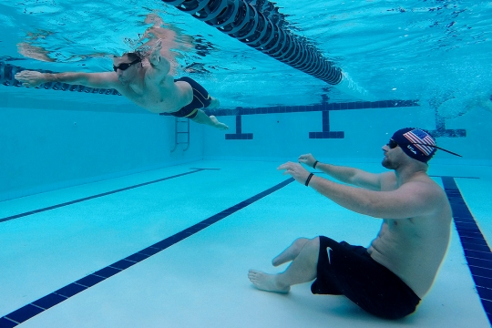 150310-N-DT805-113 Joint Base Pearl Harbor-Hickam (Mar 10, 2015) Navy Safe Harbor Wounded Warrior Brett Parks observes Redmond Ramos as he participates in Pacific Trials swimming practice at Joint Base Pearl Harbor-Hickam. The trials allow wounded, ill and injured Sailors and Coast Guardsmen from across the country to compete in cycling, seated volleyball, swimming, track and field, and wheelchair basketball at JBPHH and other locations throughout the island. The top 40 athletes will be awarded a spot on Team Navy and advance to a competition among all branches of the military. (U.S. Navy photo by Chief Mass Communication Specialist John M. Hageman/Released)