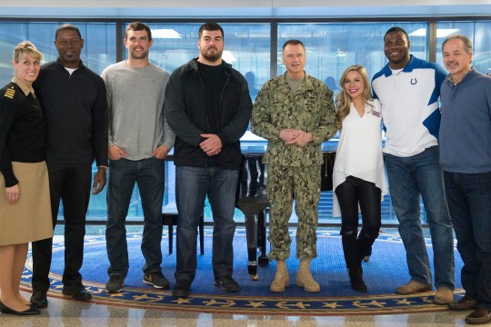 Navy Adm. James A. Winnefeld Jr., vice chairman of the Joint Chiefs of Staff, center, poses for a photo with participants in the USO tour after visiting wounded warriors at the Walter Reed National Military Medical Center in Bethesda, Md., March 2, 2015. From left: actor Dennis Haysbert; Indianapolis Colts quarterback Andrew Luck; Pittsburgh Steelers guard David DeCastro; Winnefeld; Miss America Kira Kazantsev; Indianapolis Colts tight end Dwayne Allen and NFL head coach Chuck Pagano.