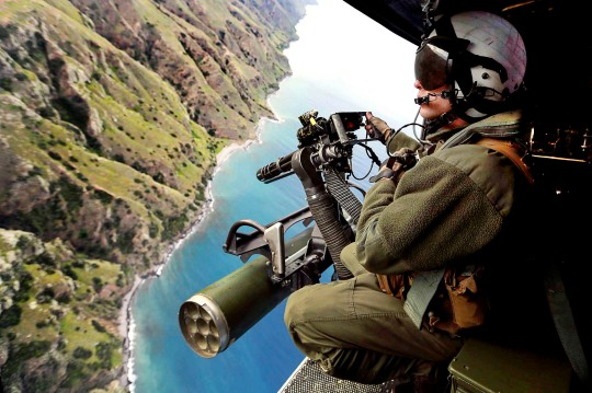 Marine Corps Lance Cpl. Zachery Johnson prepares to engage targets from a UH-1Y Venom helicopter during training over San Clemente Island, Calif., Feb. 28, 2015. Johnson is a crew chief assigned to Marine Medium Tiltrotor Squadron 161, 15th Marine Expeditionary Unit.