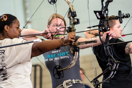 Army Trials athletes compete in the first women's archery category in Warrior Games history at Fort Bliss in El Paso, Texas March 31, 2015. From left are Jasmine Perry, Chasity Kuczer, and Laurel Cox. (DoD News photo by EJ Hersom)