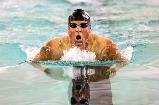 U.S. Army Staff Sgt. Max Hasson, Fort Carson WTB, Colorado,  competes in the men's 100 breaststroke during the 2015 Army Trials swimming competition at the Aquatics Training  Center, Fort Bliss, Texas, April 2. Approximately 80 wounded, ill and injured Soldiers and Veterans are at Fort Bliss, Texas to train and compete in a series of athletic events including archery, cycling, shooting, sitting volleyball, swimming, track, and field, and wheelchair basketball. Army Trials, March 29 - April 2, are conducted by the Army Warrior Transition Command and hosted by Fort Bliss. Army Trials help determine who will get a spot on the Department of Defense Warrior Games 2015 Army Team in June at Marine Corps Base, Quantico, Virginia. (U.S. Army Photo by Sgt. 1st Class Christophe D. Paul/Released)