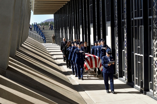 Air Force Rabbi (Maj.) Sarah Schechter reads from the Torah while the honor guard escorts the casket containing the remains of Capt. Richard D. Chorlins into the Cadet Chapel at the U.S. Air Force Academy, Colo., April 14, 2015. Chorlins was killed in Vietnam in January 1970. His remains were transferred to the academy in a dignified arrival ceremony for burial in the Academy Cemetery April 14, 2015. Schechter is a Cadet Chapel Jewish chaplain.