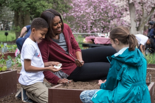 First Lady Michelle Obama joins students for the spring garden planting in the White House Kitchen Garden, April 15, 2015. (Official White House Photo by Chuck Kennedy)