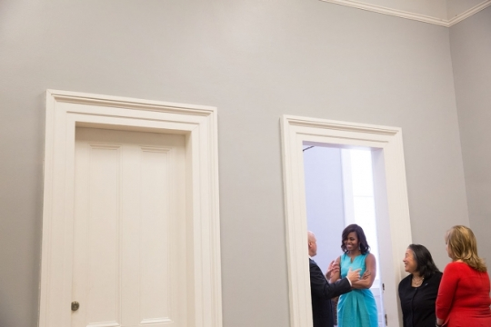 "First Lady Michelle Obama holds backstage with Mayor Mitch Landrieu and Dylan Tete prior to the ""Mayor's Challenge to End Veteran Homelessness"" Joining Forces event at Gallier Hall in New Orleans, Louisiana, April 20, 2015. (Official White House Photo by Amanda Lucidon)"