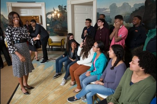 Asomugha College Tour for Scholars (ACTS) high school students react to First Lady Michelle Obama's surprise visit with them in the Diplomatic Reception Room during their tour of the White House, April 8, 2015. (Official White House Photo by Lawrence Jackson)