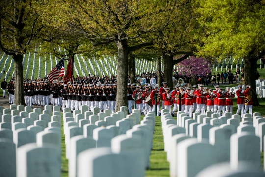 "Marines from Marine Barracks Washington (8th and I), ""The President's Own"" United States Marine Band and attendees of the graveside service for U.S. Marine Corps Maj. Elizabeth Kealey approach Section 71 in Arlington National Cemetery, April 27, 2015, in Arlington, Va. Kealey died in a helicopter crash while conducting training at Marine Corps Air Ground Combat Center Twentynine Palms, Calif., Jan. 23, according to a Marine Corps Air Station Miramar press release. (U.S. Army photo by Rachel Larue/released)"