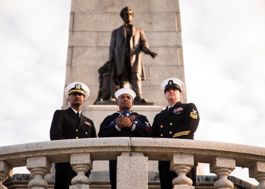 Navy Cmdr. Maurice Buford, left, Chief Petty Officer Jeremy Crandall, right, and Petty Officer 2nd Class Danian Douglas stand in front of President Abraham Lincoln's tomb in Springfield, Ill., April 15, 2015, during an event to mark the 150th anniversary of Lincoln's assassination. Crandall is a cryptologic technician. Sailors assigned to the USS Abraham Lincoln also participated in ceremonies at Ford's Theater and President Lincoln's Cottage in Washington, D.C.