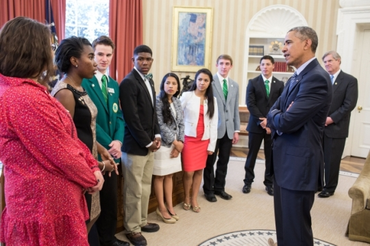President Barack Obama talks with 4-H Science, Technology, Engineering and Math (STEM) students during their visit, with Agriculture Secretary Tom Vilsack, to the Oval Office, April 13 2015. (Official White House Photo by Pete Souza)
