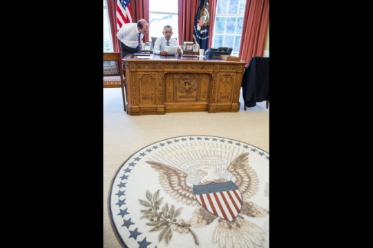 President Barack Obama goes over his statement on the Joint Comprehensive Plan of Action regarding Iran's nuclear program that was decided in Lausanne, Switzerland, with Ben Rhodes, Deputy National Security Advisor for Strategic Communications, in the Oval Office, April, 2, 2015. (Official White House Photo by Pete Souza)