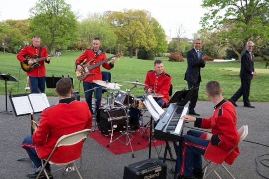 "President Barack Obama and Chief of Staff Denis McDonough stop after their walk around the South Lawn Drive to listen to the ""Jazz Combo of 'The President's Own' U.S. Marine Band"" who were playing for the President's Medicare Sustainable Growth Rate reception in the Rose Garden of the White House, April 21, 2015. (Official White House Photo by Pete Souza)"