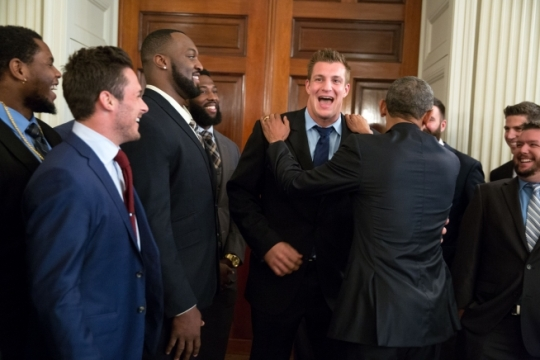 President Barack Obama jokes with tight end Rob Gronkowski, as he greets the New England Patriots in the State Dining Room, prior to an event to honor the team and their Super Bowl XLIX victory, on the South Lawn of the White House, April 23, 2015. (Official White House Photo by Pete Souza)