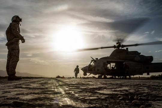 U.S. Marines refuel a UH-1Y Venom at the end of Final Exercise 3 during Weapons and Tactics Instructor Course (WTI) Course 2-15 near Yuma, Ariz., April 25, 2015. WTI is a seven-week event hosted by Marine Aviation Weapons and Tactics Squadron One (MAWTS-1) cadre. MAWTS-1 provides standardized tactical training and certification of unit instructor qualifications to support Marine aviation Training and Readiness and assists in developing and employing aviation weapons and tactics. (U.S. Marine Corps photo by Lance Cpl. Jodson B. Graves, 2nd MAW Combat Camera/Released)