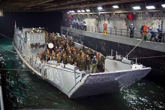 150401-N-EI510-093 WATERS EAST OF THE KOREAN PENINSULA (April 1, 2015) Landing Craft Utility (LCU) 1631 assigned to Naval Beach Unit (NBU) 7 enters the well deck of the amphibious transport dock ship USS Green Bay (LPD 20). U.S. Sailors and Marines from the Bonhomme Richard Amphibious Ready Group (ARG) and the 31st Marine Expeditionary Unit (MEU) are participating in the Korean Marine Exchange Program (KMEP) in the Republic of Korea (ROK) with the ROK marine corps and navy. The Bonhomme Richard ARG is comprised of the amphibious assault ship USS Bonhomme Richard (LHD 6), the amphibious transport dock ship USS Green Bay (LPD 20), the amphibious dock landing ship USS Ashland (LSD 48) and the embarked 31st MEU.(U.S. Navy photo by Mass Communication Specialist 3rd Class Scott Barnes/Released)