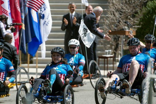 President Barack Obama applauds wounded warrior cyclists at the White House in Washington, D.C., April 16, 2015. Wounded military veterans from each service rode their cycles around the White House south lawn to raise awareness for wounded veterans as part of the annual Wounded Warrior Project's soldier ride