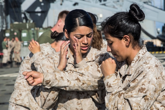 U.S. Marines Lance Cpl. Jasmine Castaneda, left, and Lance Cpl. Karina Navarro-Aguilera practice blocking techniques during Marine Corps Martial Arts Program training aboard the USS Rushmore (LSD 47) at sea in the Pacific Ocean, May 26, 2015. Castaneda is a supply warehouse clerk and Navarro-Aguilera is a supply administrative clerk, both with Combat Logistics Battalion 15, 15th Marine Expeditionary Unit. MCMAP focuses on hand-to-hand combat training essential to mission readiness while deployed with the 15th MEU. (U.S. Marine Corps photo by Sgt. Emmanuel Ramos/Released)