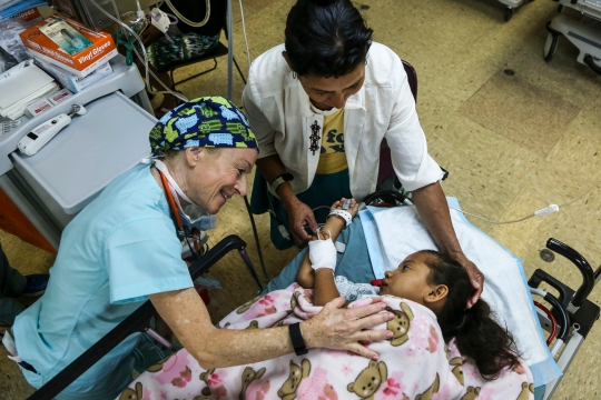 150518-A-BK746-111  CARIBBEAN SEA (May 18, 2015) Dr. Judith Brill, a physician volunteering with the non-governmental organization Operation Smile, comforts a Nicaraguan patient in the post-operating room aboard the Military Sealift Command hospital ship USNS Comfort (T-AH 20) during Continuing Promise 2015. Operation Smile volunteer medical professionals will provide free cleft lip and cleft palate surgery to hundreds of patients during Continuing Promise.  Continuing Promise is a U.S. Southern Command-sponsored and U.S. Naval Forces Southern Command/U.S. 4th Fleet-conducted deployment to conduct civil-military operations including humanitarian-civil assistance, subject matter expert exchanges, medical, dental, veterinary and engineering support and disaster response to partner nations and to show U.S. support and commitment to Central and South America and the Caribbean. (U.S. Army photo by Spc. Lance Hartung/Released)