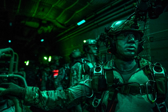 U.S. Air Force combat controllers, 21st Special Tactics Squadron, prepare to free-fall jump out of an MC-130H Combat Talon II over Marianna Municipal Airport, Fla., April 29, 2015. Emerald Warrior is the Department of Defense's only irregular warfare exercise, allowing joint and combined partners to train together and prepare for real world contingency operations. (U.S. Air Force photo by Cory D. Payne/Released)