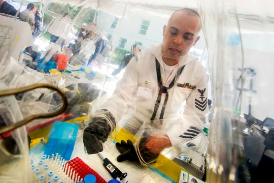 Navy Petty Officer 1st Class Mark Salvador of the Naval Medical Research Center demonstrates how a field containment kit is used to test viruses such as the Ebola virus during the Department of Defense Lab Day at the Pentagon in Arlington, Va.  May 14, 2015.  (Department of Defense photo by EJ Hersom)