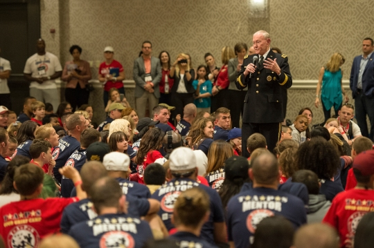 18th Chairman of the Joint Chiefs of Staff Gen. Martin E. Dempsey talks with surviving children at the 21st annual T.A.P.S. National Military Survivor Seminar and Good Grief Camp for Young Survivors, in Arlington, Va., May 22, 2015. Gen. Dempsey addressed surviving family members of fallen service members from both behind a podium and behind a microphone as he sang a few songs. (DoD photo by Mass Communication Specialist 1st Class Daniel Hinton/released)
