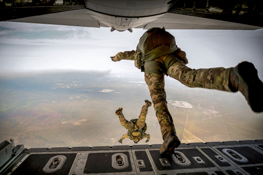 U.S. Army Green Berets from the 7th Special Forces Group jump out of a C-130H3 Hercules for Emerald Warrior at Hurlburt Field, Fla., April 22, 2015. Emerald Warrior is the Department of Defense's only irregular warfare exercise, allowing joint and combined partners to train together and prepare for real-world contingency operations. (U.S. Air Force photo by Tech. Sgt. Joshua J. Garcia /Released)