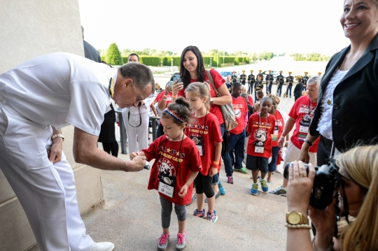 Vice Chairman of the Joint Chiefs of Staff Admiral Sandy Winnefeld greets members of the Tragedy Assistance Program for Survivors at the Pentagon, May 22, 2014. The Pentagon hosted the families for a night of fun and remembrance in honor of Memorial Day. DoD photo by Petty Officer 2nd Class Sean Hurt/ Released.