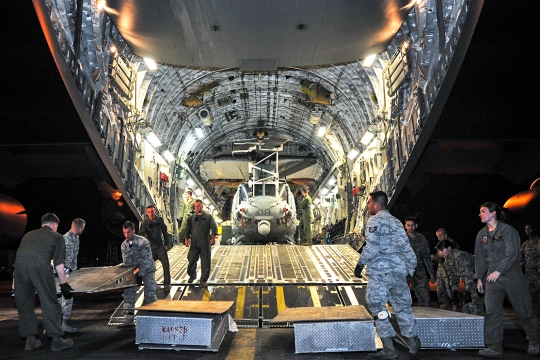 Airmen from the 36th Contingency Response Group and U.S. Marines to prepare to unload a U.S. Marine UH-1Y Huey helicopter from a U.S. Air Force C-17 Globemaster III, at Tribhuvan International Airport, May 5, 2015. The 36th CRG is a rapid-deployment unit designed to establish and maintain airfield operations in a forward operating location and joined U.S. Department of State and U.S. Agency for International Development led humanitarian assistance and disaster relief operations in support of the government and armed forces of Nepal. (U.S. Air Force photo by Staff Sgt. Melissa White/Released)