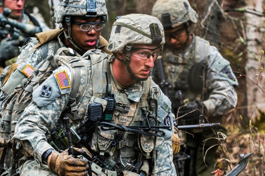 Staff Sgt. Heath Beesley, (center) weapons squad leader with 3rd platoon, Charlie Company, 3rd Battalion (Airborne) 509th Infantry Regiment waits for the command to attack during a Combined Arms Maneuver Live Fire Exercise on Joint Base Elmendorf-Richardson, Alaska, May 8, 2015. The exercise was part of the 4th Infantry Brigade Combat Team (Airborne), 25th Infantry Division exercise Spartan Phoenix. (U.S. Army photo by Staff Sgt. Daniel Love)