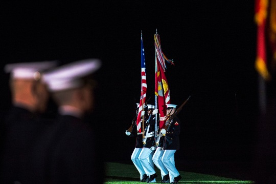 A United States Marine Corps color guard present the colors at the Evening Parade at the Marine Barracks in Washington D.C., where Deputy Secretary of Defense Bob Work was the invited guest of honor May 22, 2015. (Photo by Master Sgt. Adrian Cadiz)(Released)