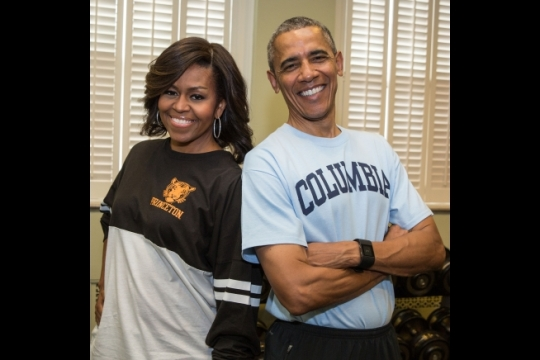 """President Barack Obama and First Lady Michelle Obama sport their college t-shirts in support of the First Lady's """"Reach Higher"""" initiative on College Signing Day, 2015. (Official White House Photo by Pete Souza)"""