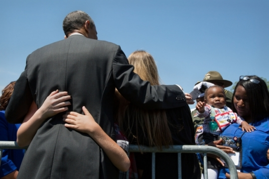 President Barack Obama hugs people after his remarks at the National Peace Officers Memorial Service, an annual ceremony honoring law enforcement who were killed in the line of duty in the previous year, at the U.S. Capitol in Washington, D.C. May 15, 2015. (Official White House Photo by Pete Souza)