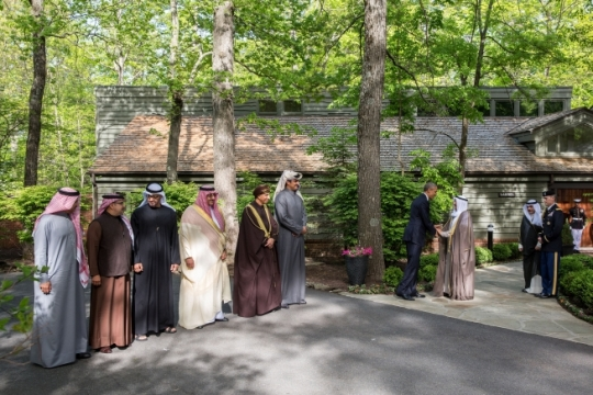 President Barack Obama shakes hands with His Highness Sheikh Sabah Al-Ahmad Al-Jaber Al Sabah, Amir of the State of Kuwait, as Gulf Cooperation Council (GCC) leaders prepare to have a group photo with the President outside of the Laurel Cabin at the conclusion of a summit meeting at Camp David, Md., May 14, 2015. (Official White House Photo by Pete Souza)