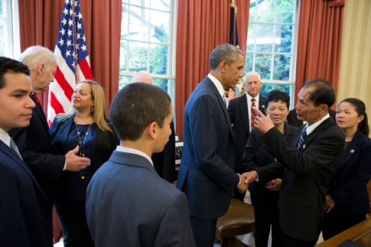President Barack Obama and Vice President Joe Biden greet the families of slain Officers Ramos and Liu after the signing of the Rafael Ramos and Wenjian Liu National Blue Alert Act of 2015 in the Oval Office, May 19, 2015. The bill is to establish an alert system for police threats in the wake of the ambush killings of the two NYPD officers in Brooklyn, N.Y. (Official White House Photo by Pete Souza)