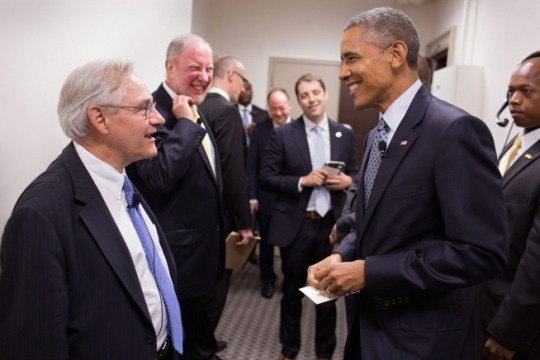 President Barack Obama talks backstage with moderator E. J. Dionne, Jr., left, Washington Post columnist and professor in Georgetown's McCourt School of Public Policy, before the Catholic-Evangelical Leadership Summit on Overcoming Poverty, at Georgetown University in Washington, D.C., May 12, 2015. Other panelists backstage are, from left, Robert Putnam, professor of public policy at the Harvard University John F. Kennedy School of Government and Arthur Brooks, president of the American Enterprise Institute. (Official White House Photo by Pete Souza)