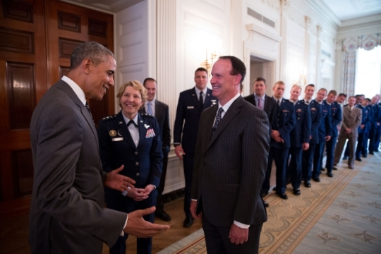 President Barack Obama greets Coach Troy Calhoun, Lt. Gen. Michelle D. Johnson, Superintendent, U.S. Air Force Academy, and the United States Air Force Academy football team in the State Dining Room before presenting the team with the Commander-in-Chief Trophy in the East Room of the White House, May 7, 2015. (Official White House Photo by Pete Souza)