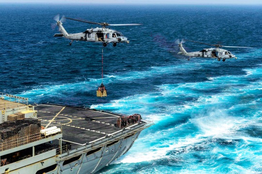150520-N-KU391-164 U.S. 5TH FLEET AREA OF OPERATIONS (May 20, 2015) An MH-60S Sea Hawk helicopter assigned to the Sea Knights of Helicopter Sea Combat Squadron (HSC) 22 picks up supplies from the Military Sealift Command Fast Combat Support Ship USNS Arctic (T-AOE 8) during an underway replenishment with the aircraft carrier USS Theodore Roosevelt (CVN 71). Theodore Roosevelt is deployed in the U.S. 5th Fleet area of operations supporting Operation Inherent Resolve, strike operations in Iraq and Syria as directed, maritime security operations and theater security cooperation efforts in the region. (U.S. Navy photo by Mass Communication Specialist 3rd Class Josh Petrosino/Released)