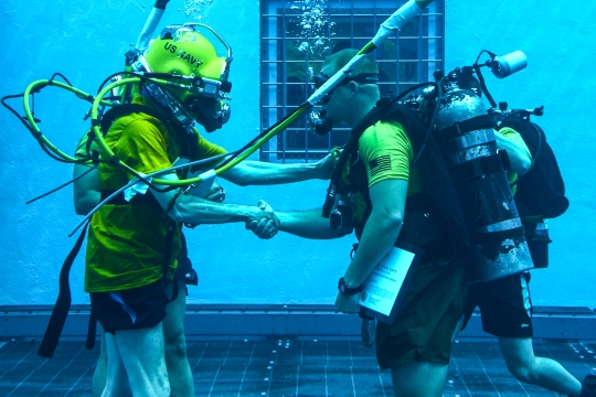 150527-N-TI693-082  PANAMA CITY, Fla. (May 27, 2015) Secretary of the Navy (SECNAV) Ray Mabus presents an award to Gunnery Sgt. Bo Irving, a Marine Corps combatant diver course instructor, in the aquatic training facility at Naval Diving and Salvage Training Center. NDSTC is the largest diving training facility in the world and is home of the military diver. (U.S. Navy photo by Mass Communication Specialist Fred Gray IV/Released)