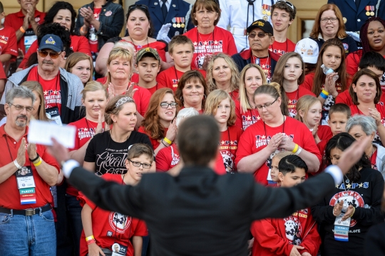 Defense Secretary Ash Carter welcomes families of the Tragedy Assistance Program for Survivors, known as TAPS, to the Pentagon, May 22, 2015. The program offers support for military families who have lost a family member serving in the military.