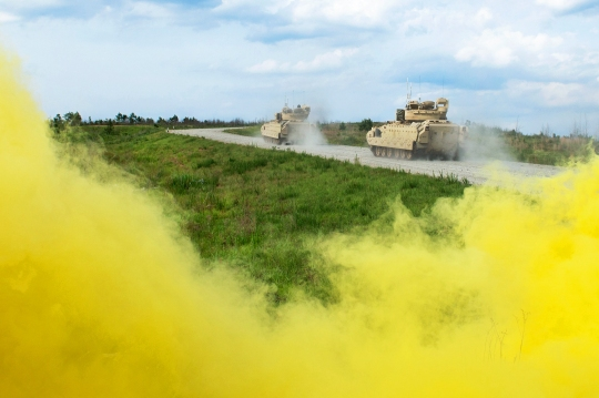 (FORT BENNING) Yellow smoke fills the air at the Digital Multi-Purpose Range Complex May 14-15, 2015 during a Combined Arms Live-Fire Exercise. The smoke is a signal to follow on forces that the line is clear. (Photo by Patrick A. Albright/U.S. Army)