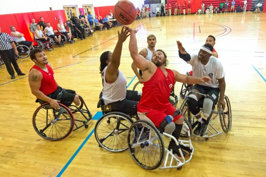 Teams Marine Corps and Army battle for a rebound during wheelchair basketball preliminary rounds for the 2015 Department of Defense Warrior Games at Marine Corps Base Quantico, Va. June 20, 2015. (Department of Defense photo by EJ Hersom)